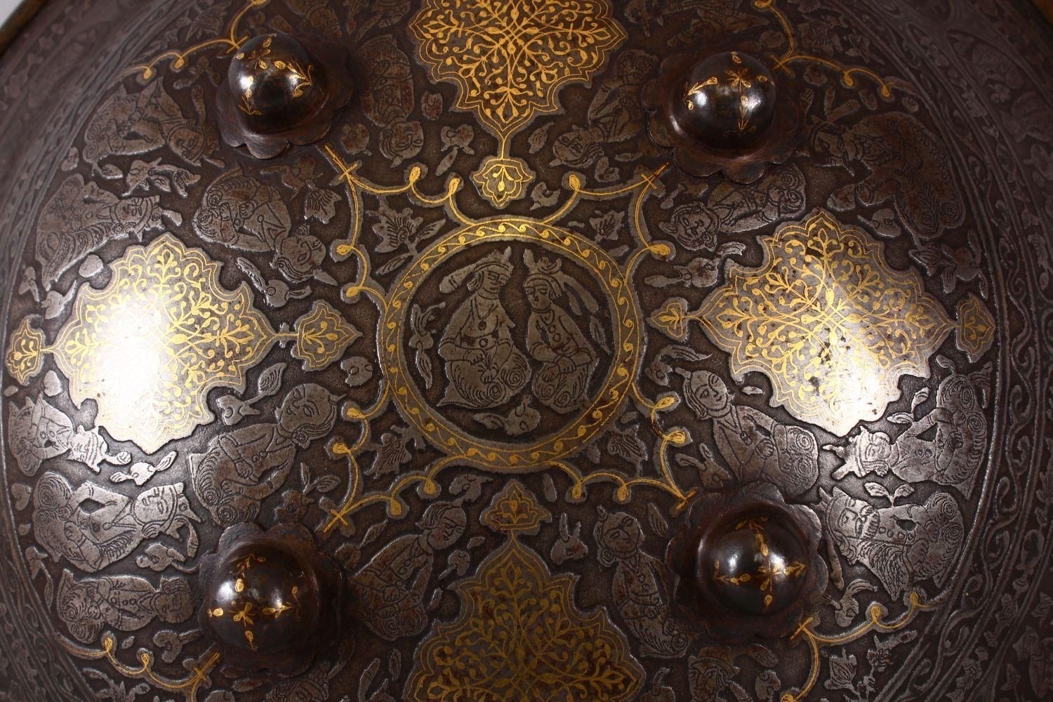 A LARGE 19TH CENTURY PERSIAN GILT DECORATED STEEL SHIELD, with carved decoration of figures, bands - Image 2 of 12