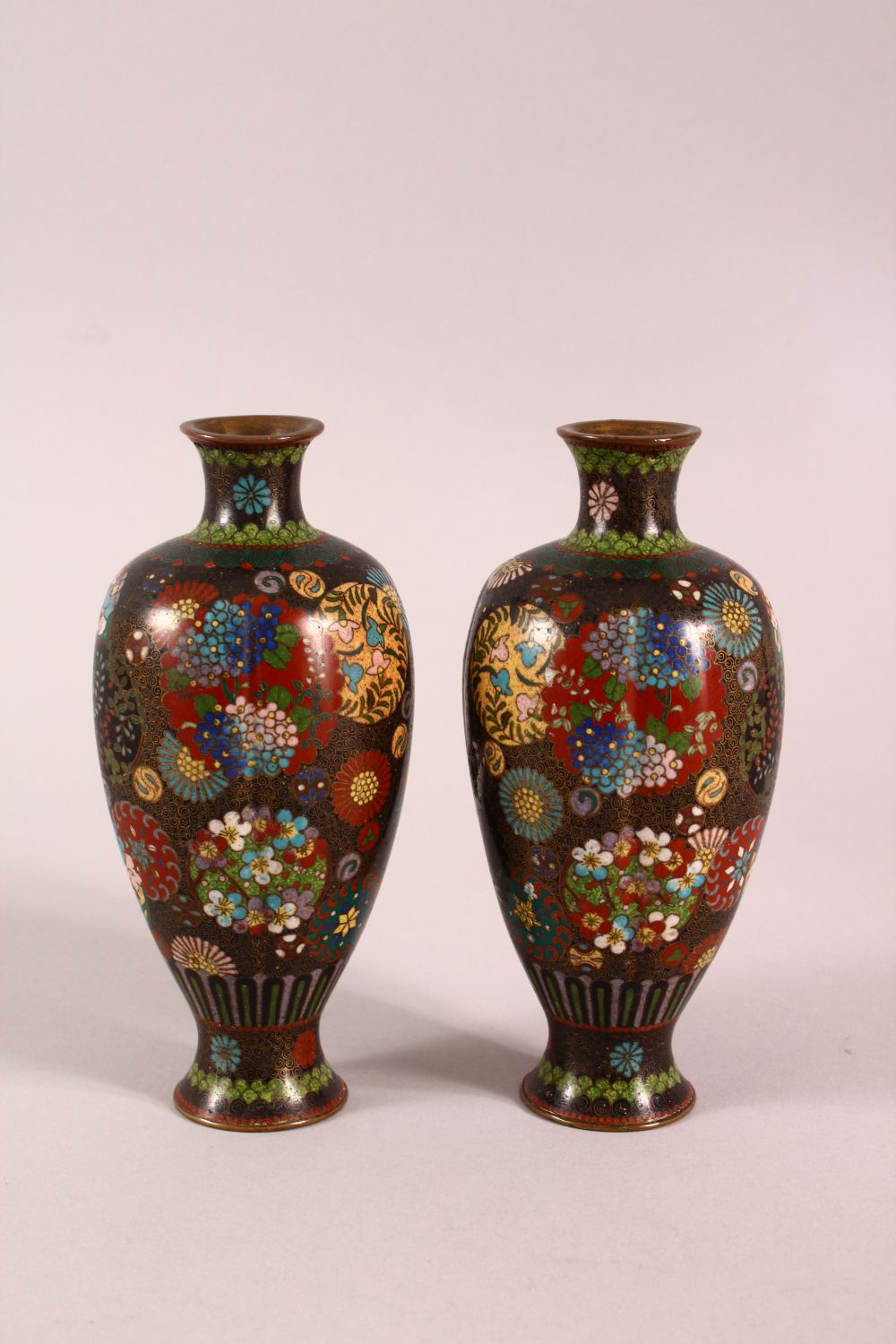 A PAIR OF SMALL CLOISONNE VASES OF RIBBED BALUSTER FORM, decorated with roundels of flowers, 15cm - Image 3 of 6