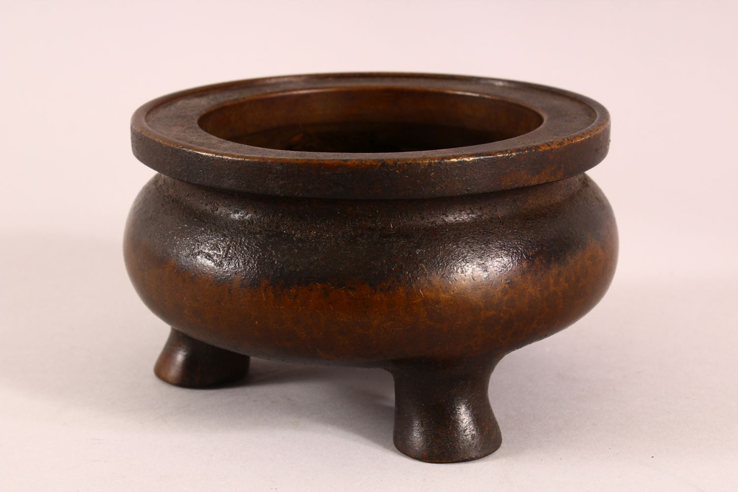A CHINESE XUANDE STYLE BRONZE TRIPOD CENSER, underside with a mark, 16cm - Image 4 of 7