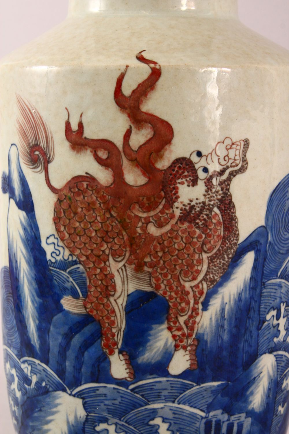 A CHINESE UNDERGLAZE BLUE & COPPER RED PORCELAIN VASE, decorated with lion dogs and waves, six - Image 5 of 8