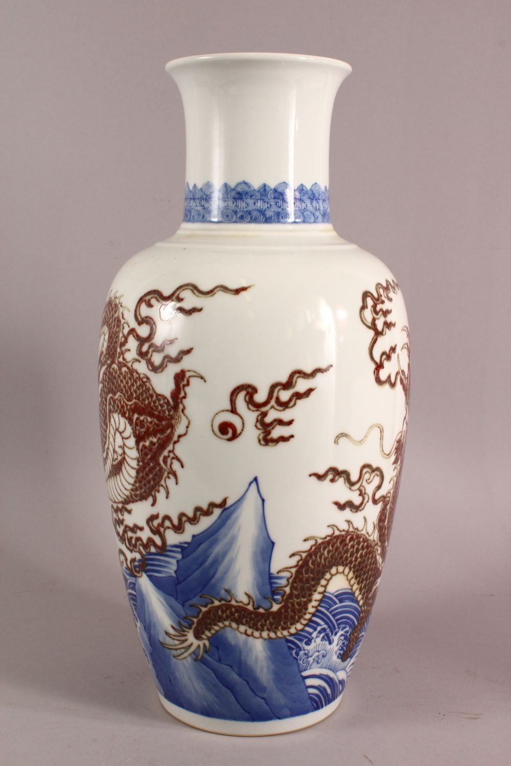 A LARGE CHINESE UNDERGLAZE BLUE & COPPER RED PORCELAIN VASE, decorated with dragons amongst waves, - Image 5 of 7