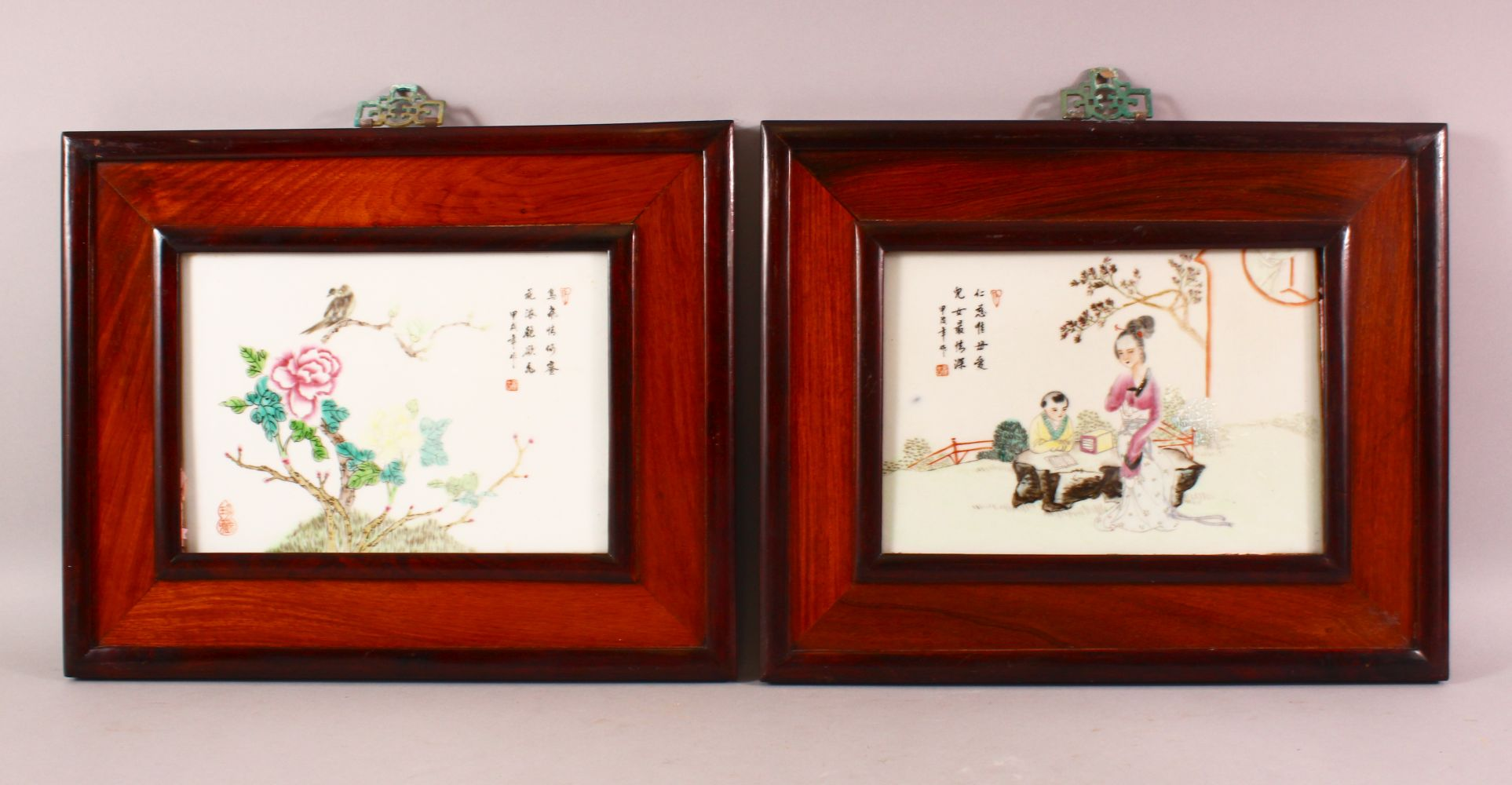 A PAIR OF CHINESE FAMILLE ROSE PORCELAIN PANELS, depicting birds and flora, mother and child, each