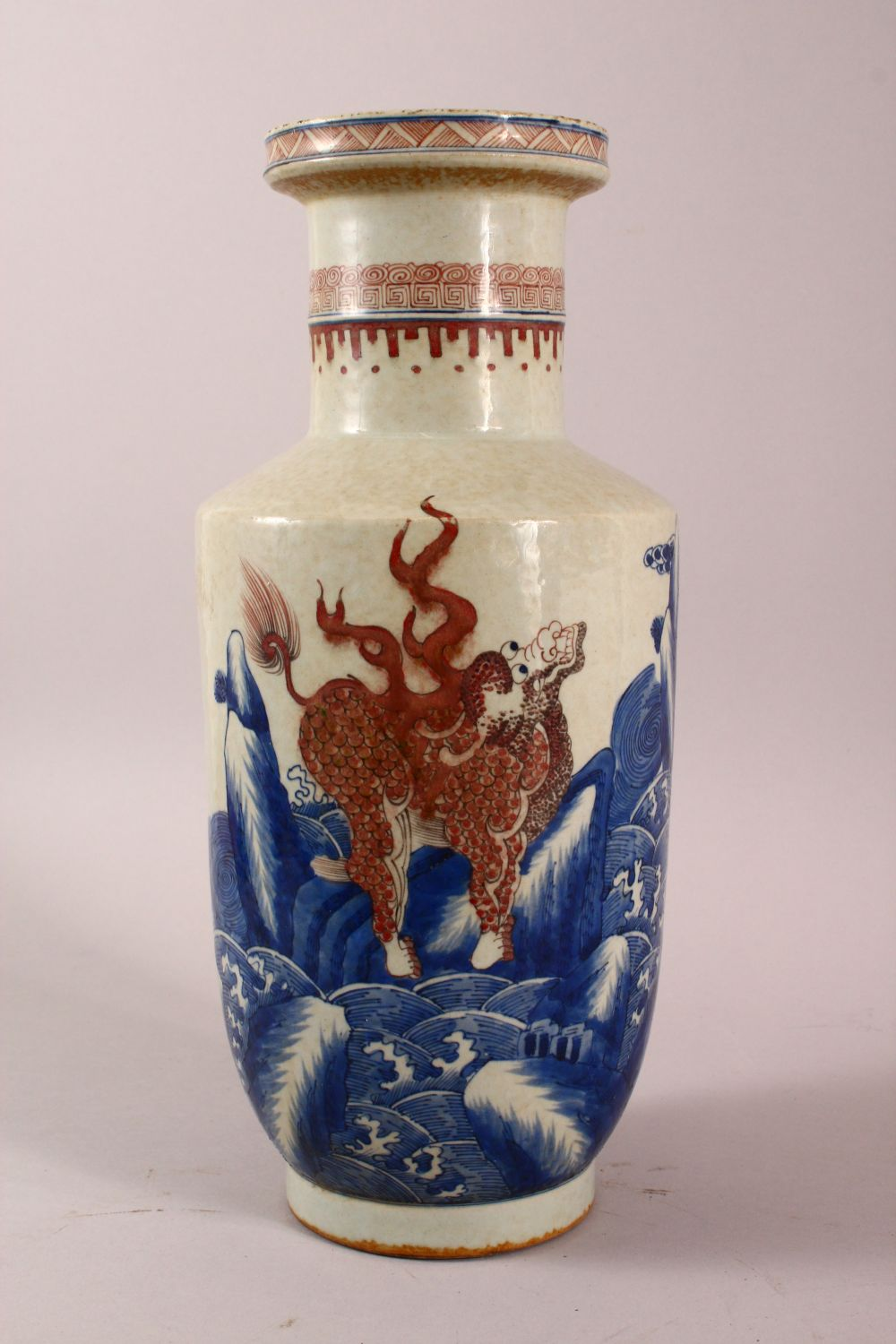 A CHINESE UNDERGLAZE BLUE & COPPER RED PORCELAIN VASE, decorated with lion dogs and waves, six - Image 4 of 8