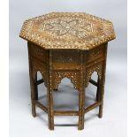 A GOOD MOORISH BONE INLAID OCTAGONAL TABLE with folding base, 62cm diameter, 62cm high.