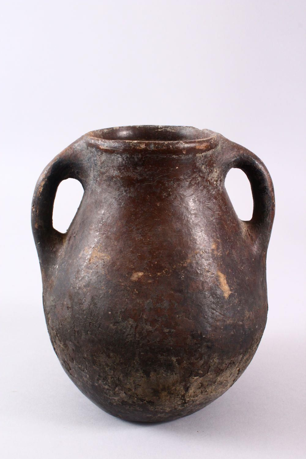 A 10TH CENTURY IRANIAN POTTERY TWIN HANDLE JUG, 22cm high. - Image 3 of 5
