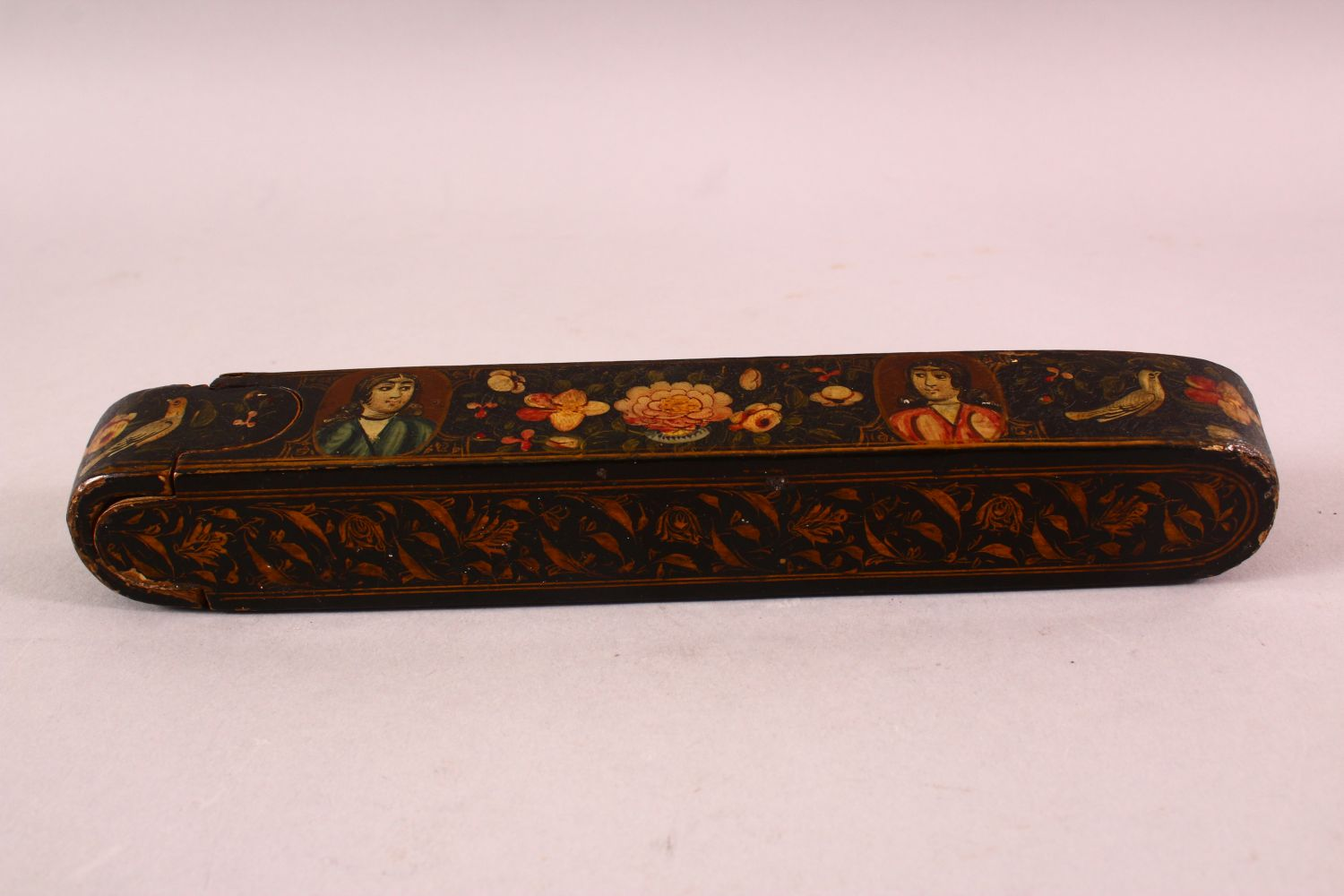 A PERSIAN QAJAR LACQUERED PEN BOX containing the brass inkwell, 23cm long. - Image 5 of 5