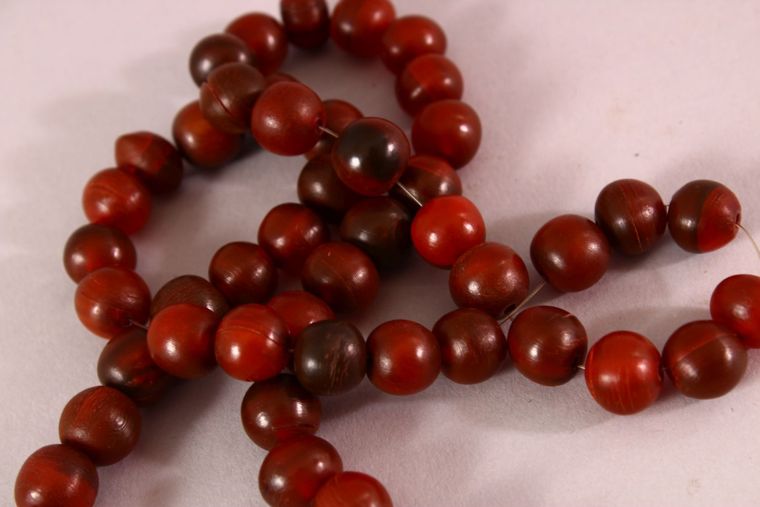 A RHINO HORN BEAD NECKLACE, beads approx 10mm diameter, weight 65g. - Image 2 of 3