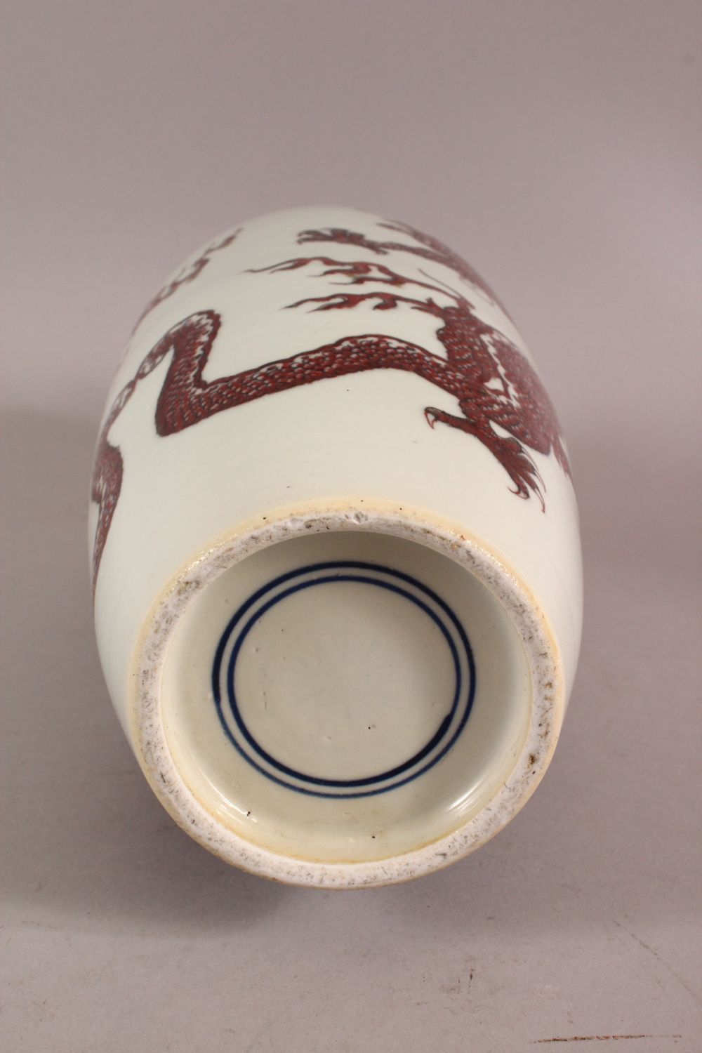 A CHINESE COPPER RED GLAZED PORCELAIN DRAGON VASE, with double blue rings to base, 32cm - Image 5 of 5