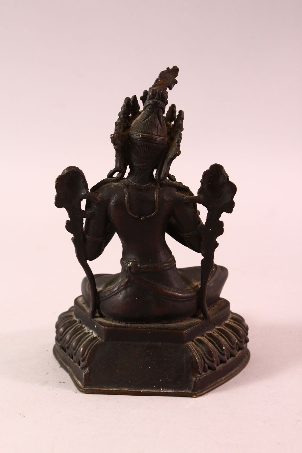 A 19TH CENTURY INDIAN BRONZE FIGURE OF SHIVA / DEITY, in a seated pose with hands together, upon - Image 3 of 5
