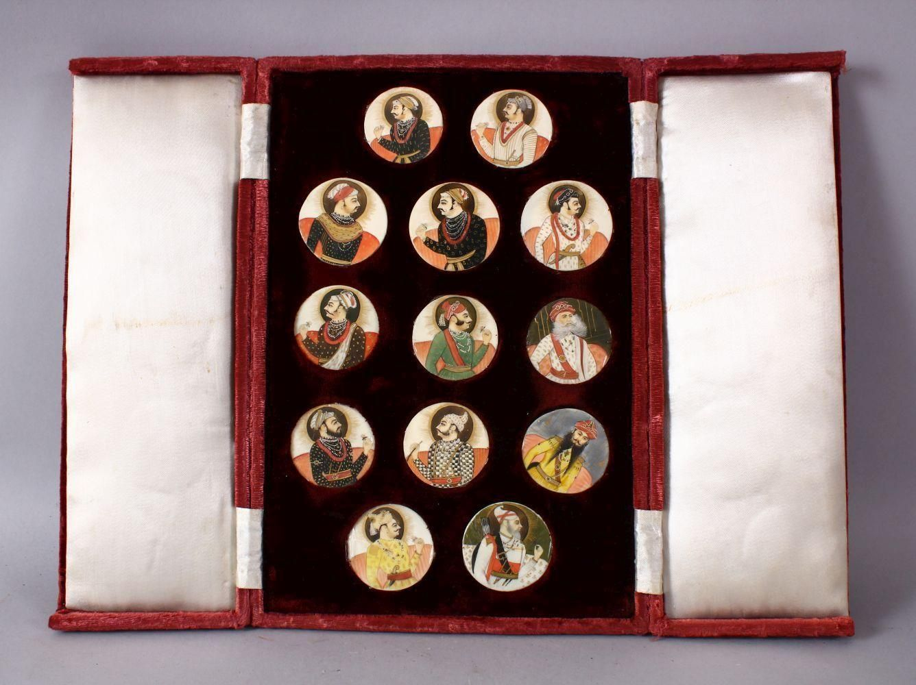 A BOXED SET OF THIRTEEN 18TH/19TH CENTURY PERSIAN CARVED & PAINTED IVORY MINIATURES, each of the