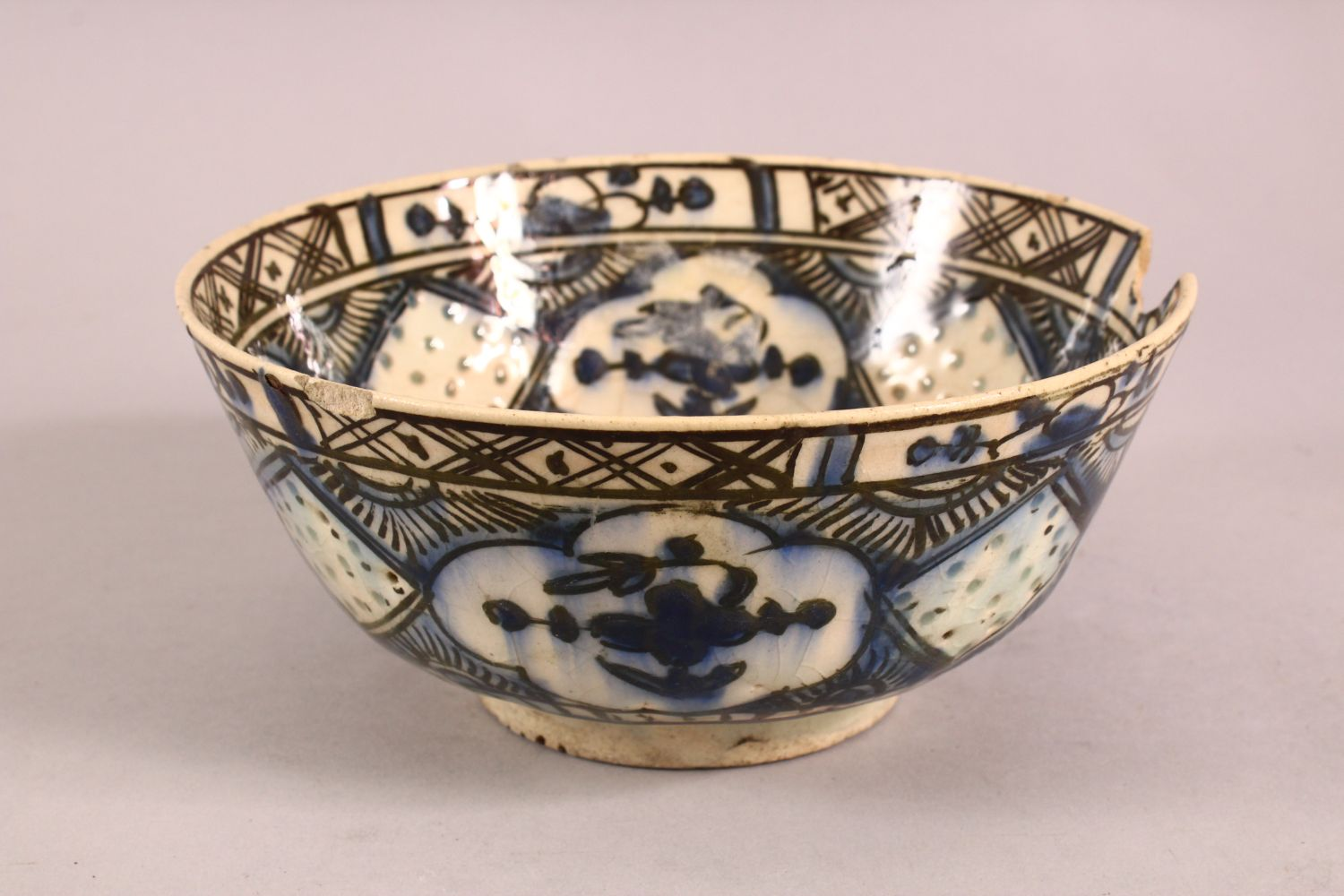 A 19TH CENTURY OR EARLIER TURKISH POTTERY BOWL, with floral motif decorations, (af) 18.5cm - Image 2 of 6