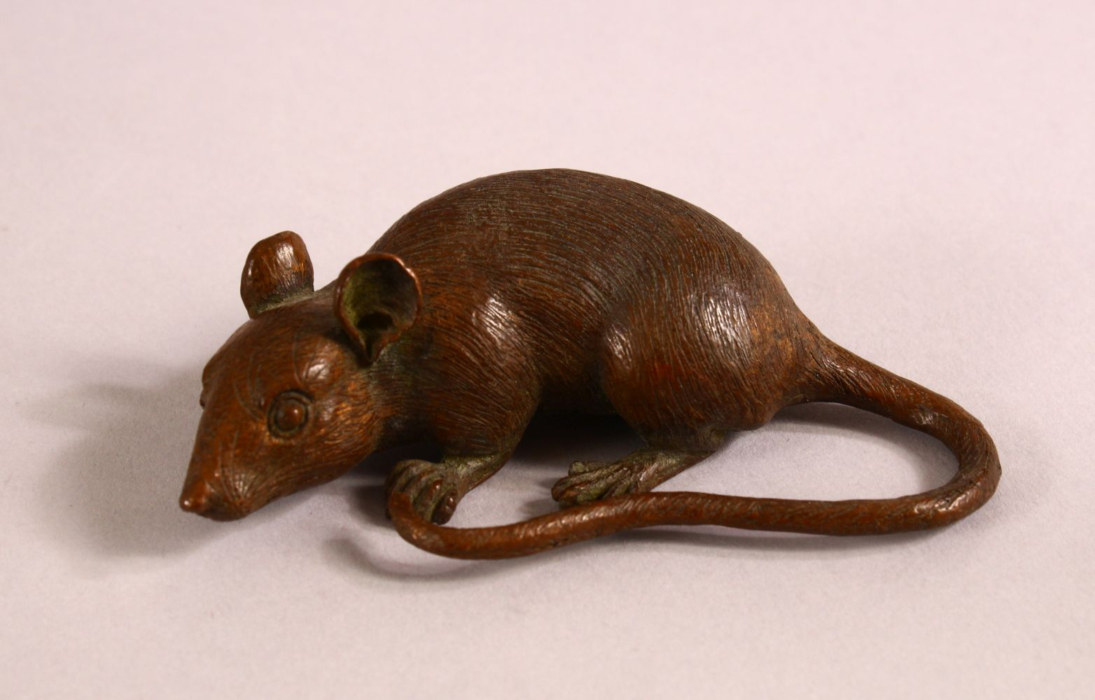 A JAPANESE BRONZE FIGURE OF A RAT, the underside with a mark, 9cm