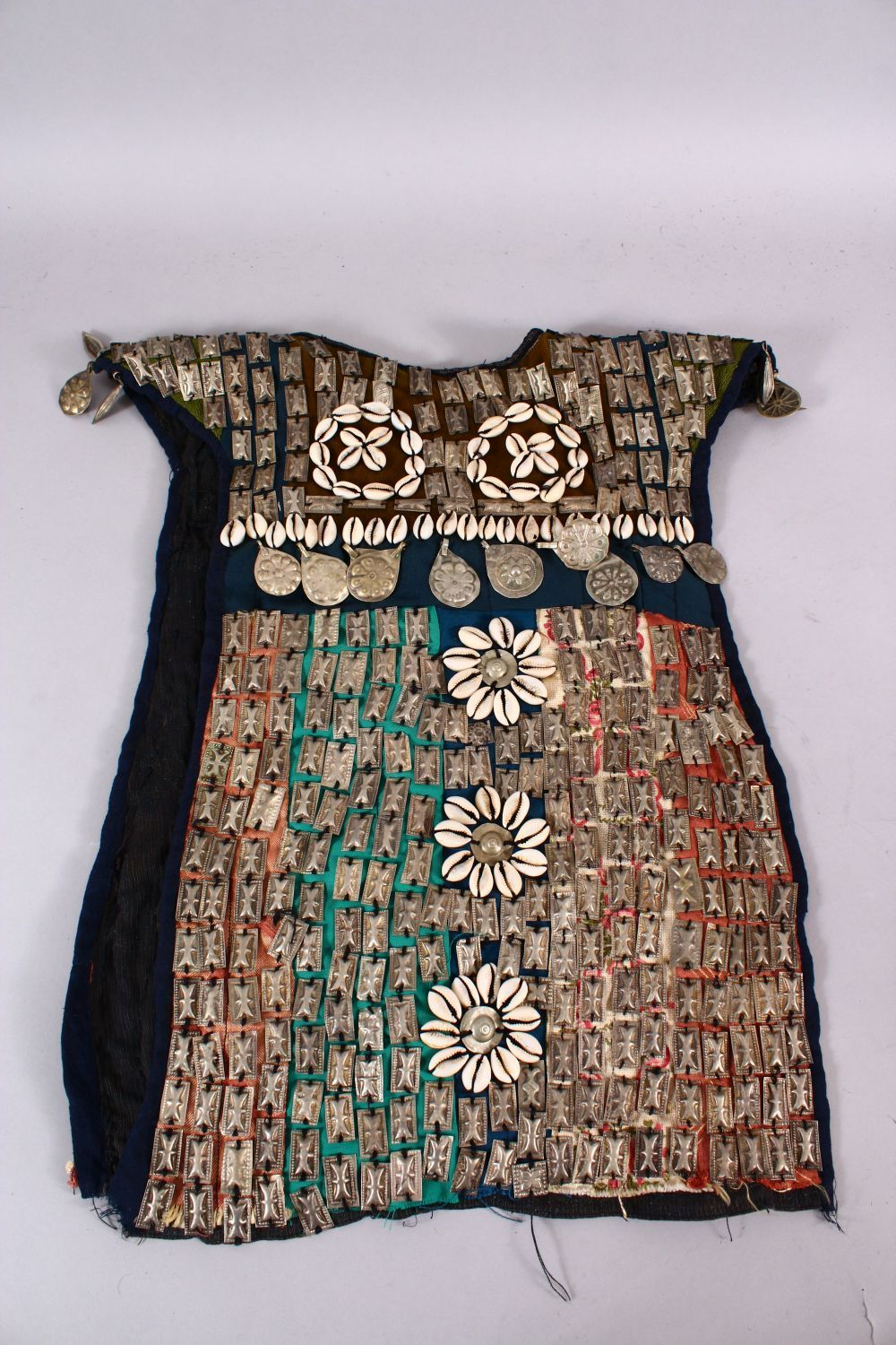 A 19TH CENTURY TURKISH SILVER ONLAID CHILDS DRESS, with silver roundel and shell applications. - Image 5 of 7
