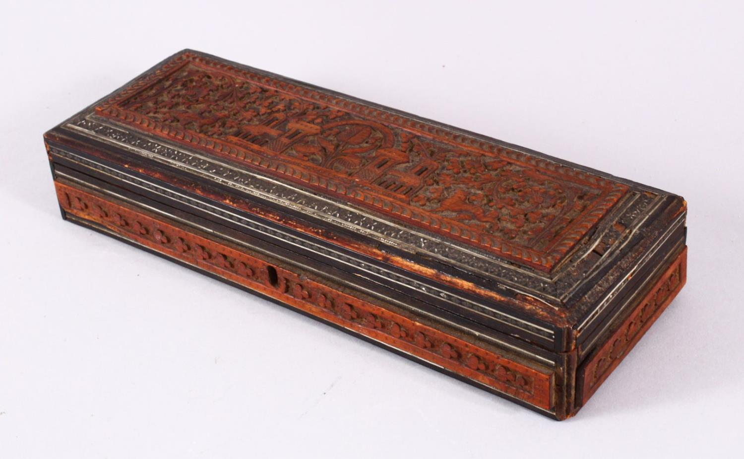 A 19TH / 20TH CENTURY INDIAN CARVED WOODEN BOX, carved with temples, animals and foliage, with