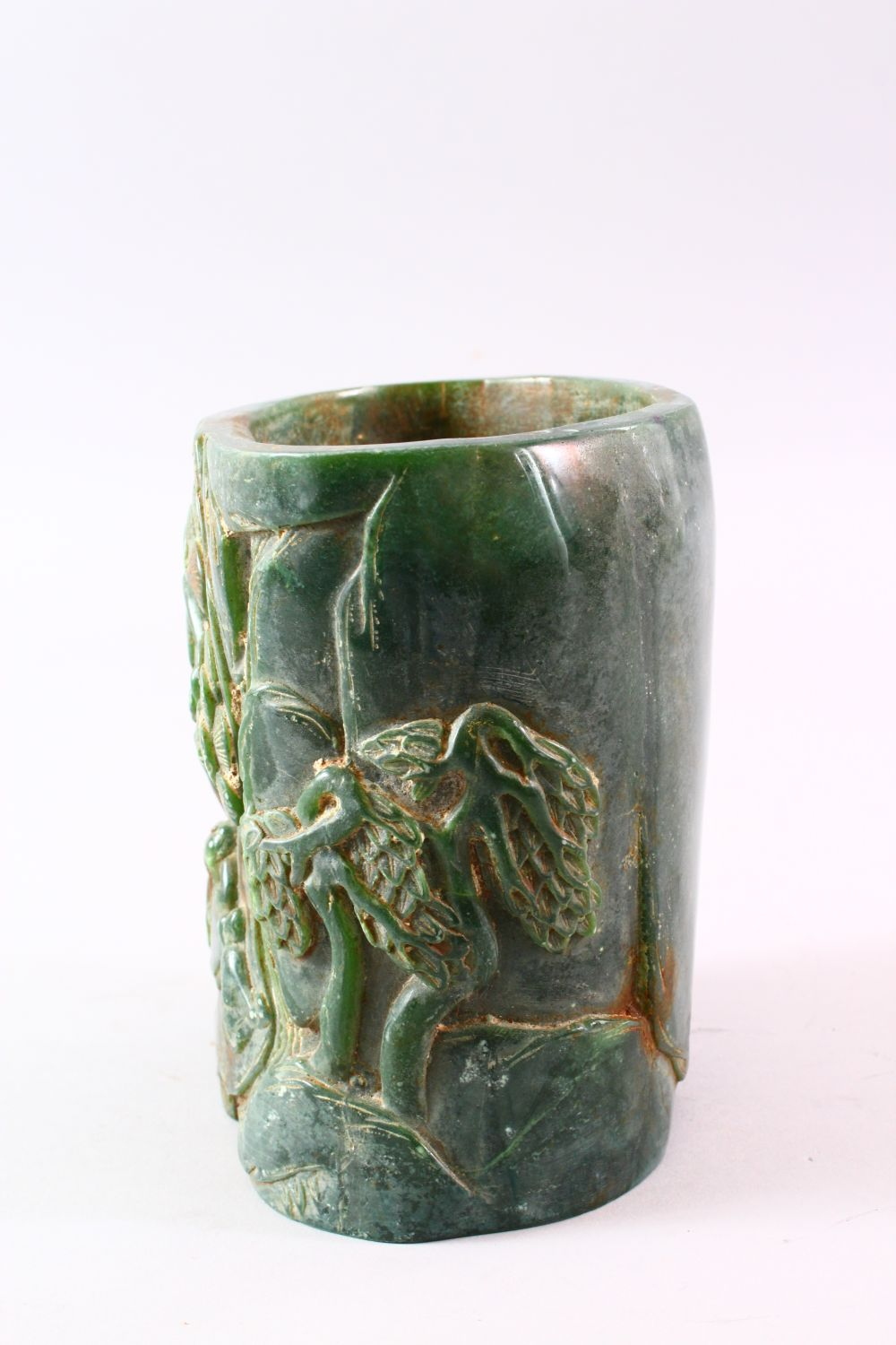 A CHINESE GREEN HARDSTONE BRUSH POT, carved with figures and trees, calligraphy, 15.5cm high. - Image 4 of 7