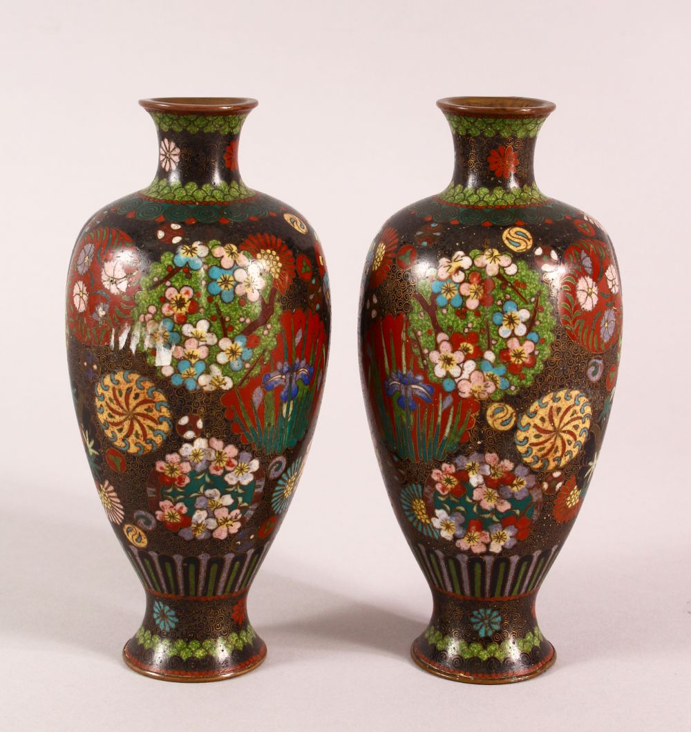 A PAIR OF SMALL CLOISONNE VASES OF RIBBED BALUSTER FORM, decorated with roundels of flowers, 15cm