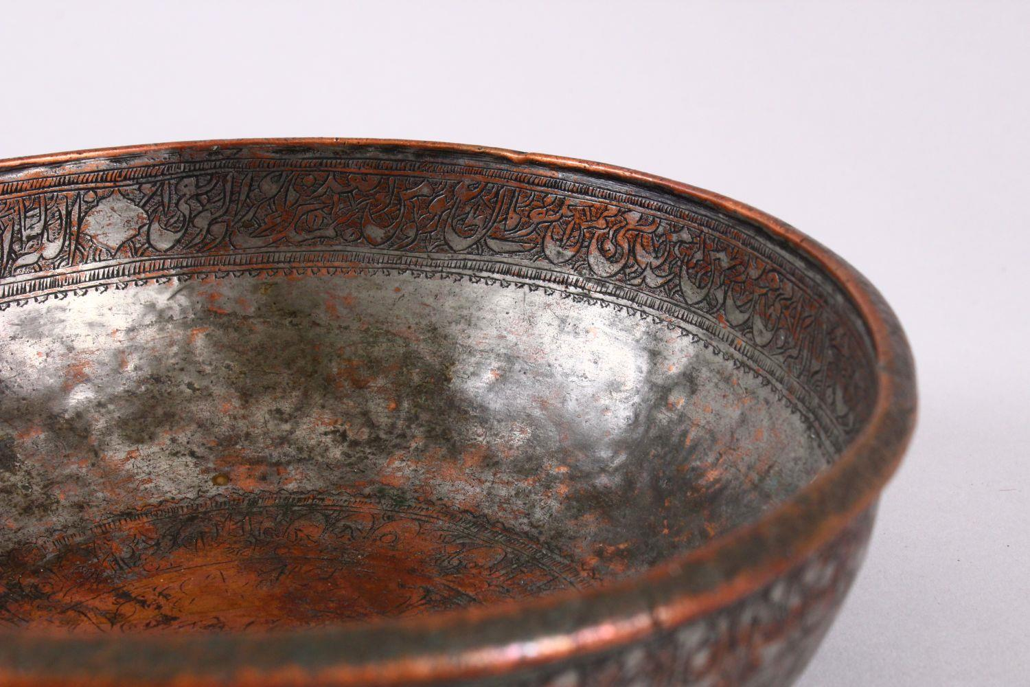 A UNUSUAL ISLAMIC TINNED HAMMERED COPPER CALLIGRAPHIC BOWL, decorated with interior & exterior bands - Image 4 of 8