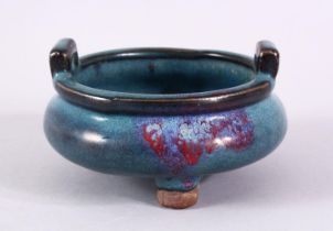 A CHINESE JUN WARE TWIN HANDLE CENSER, with a graduated blue to red glaze, twin handles and tripod