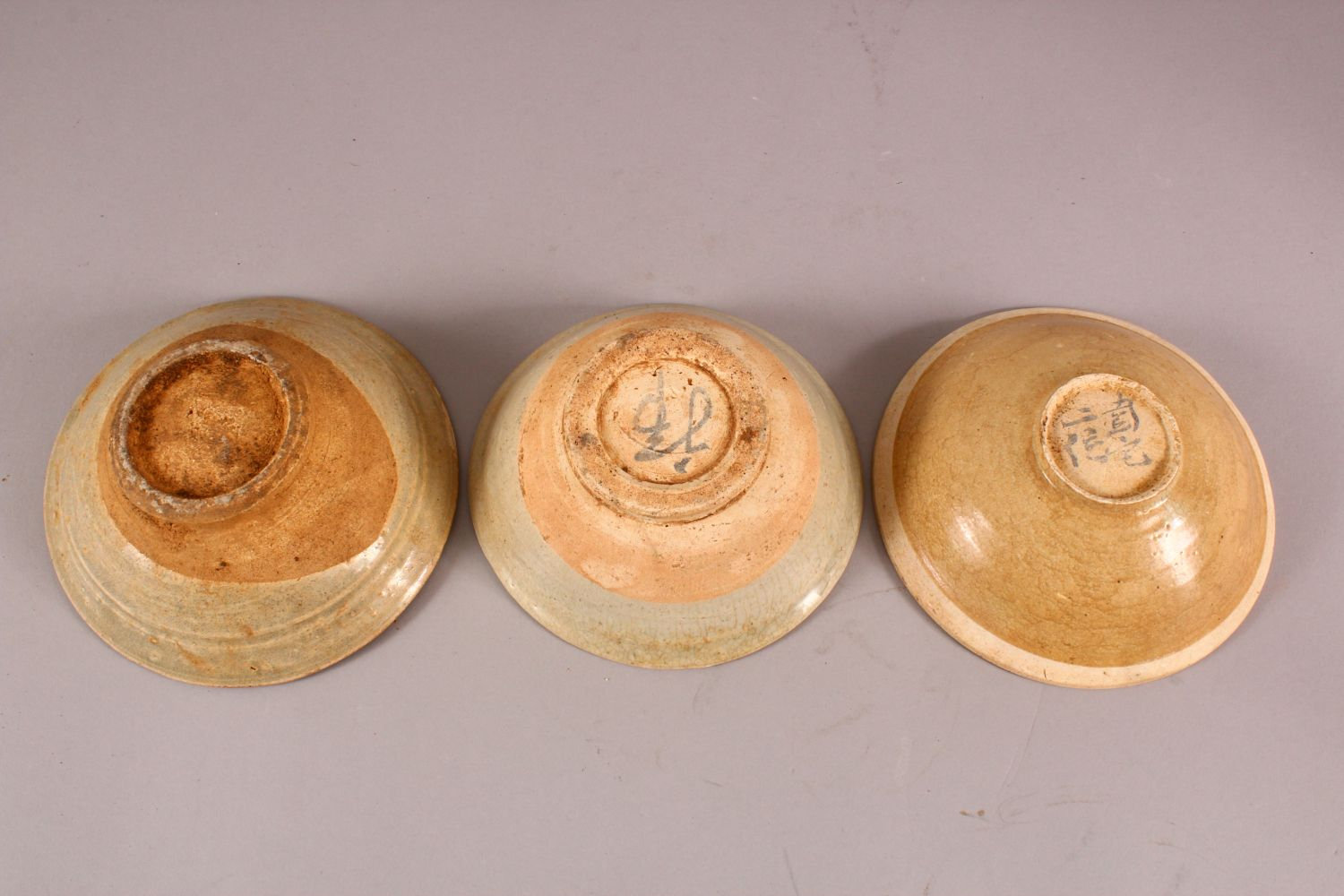 THREE EARLY CHINESE POTTERY BOWLS, of varying style and size (3) - Image 2 of 2