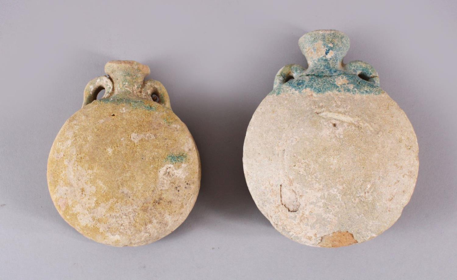 TWO 10TH CENTURY IRANAIN POTTERY TWIN HANDLE BOTTLES, each with traces of turquoise glaze to the