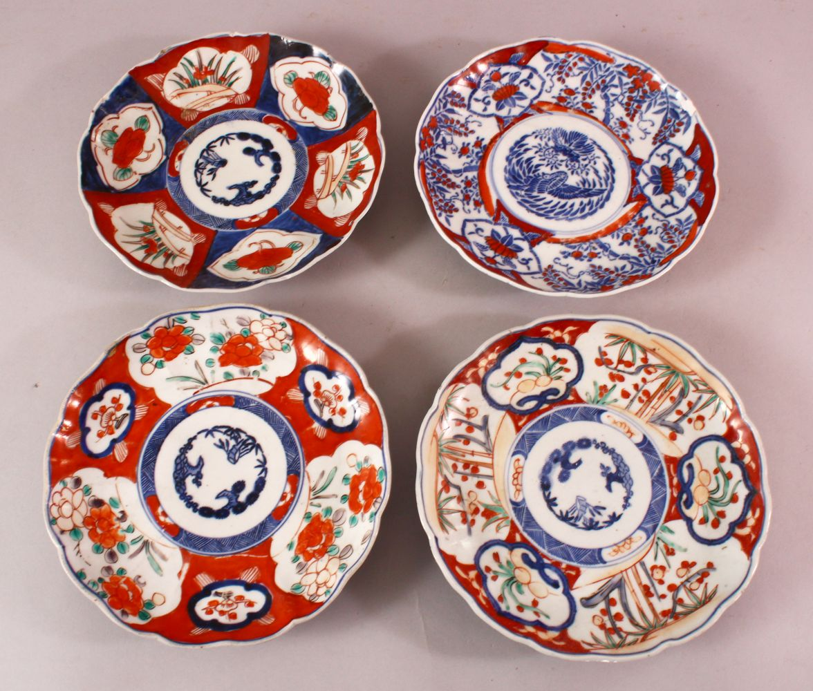 FOUR JAPANESE MEIJI PERIOD IMARI PORCELAIN PLATES, each with varying decoration in typical palate,