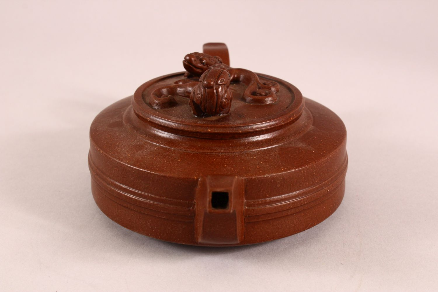A CHINESE YIXING CLAY TEAPOT, with moulded beast like figures, the underside of the pot and lid with - Image 2 of 8