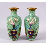 A PAIR OF CHINESE CLOISONNE APPLE GREEN GROUND VASES - each with a green ground with native