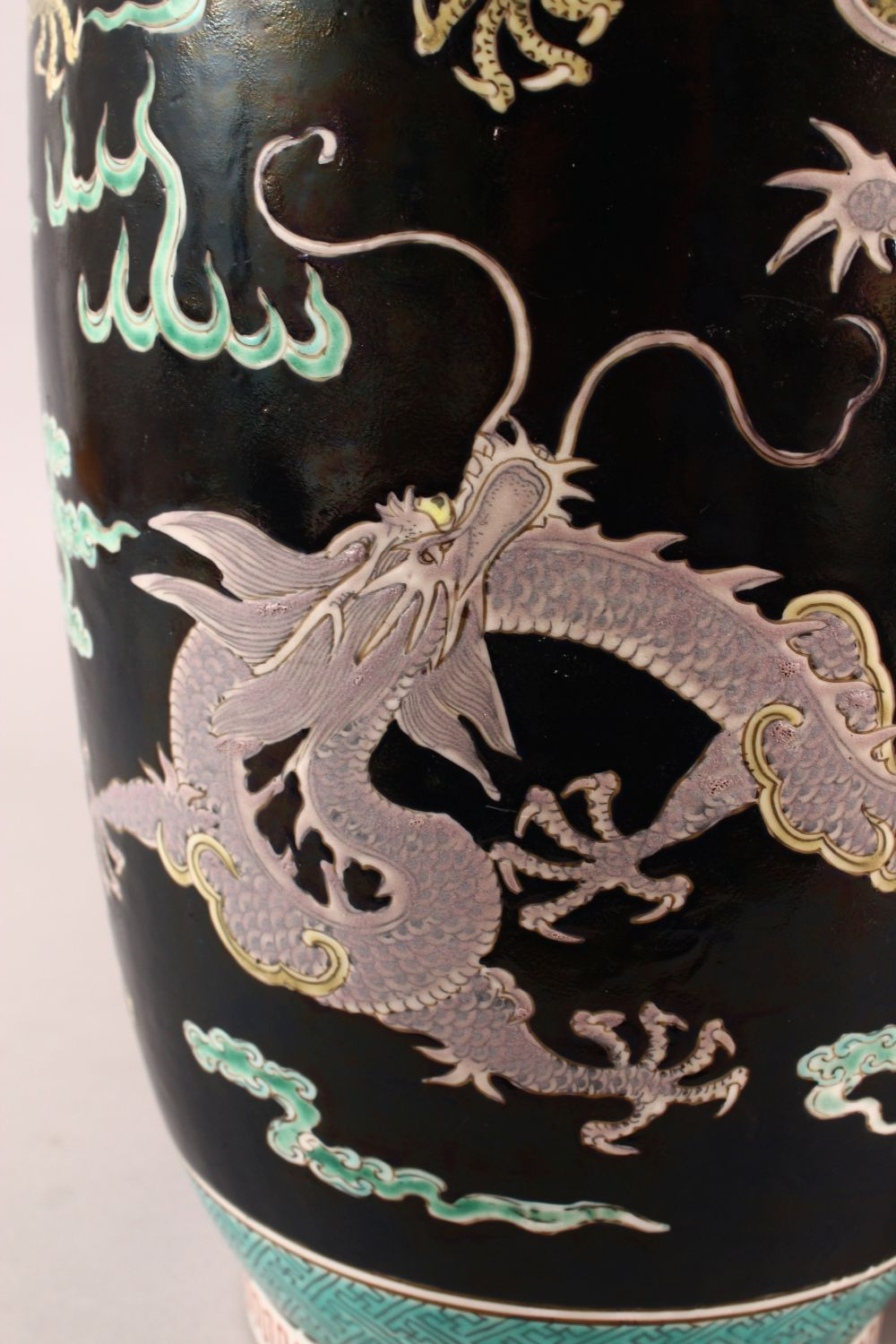 A LARGE PAIR OF CHINESE FAMILLE NOIR PORCELAIN DRAGON VASES, each vase with a black ground depicting - Image 8 of 13