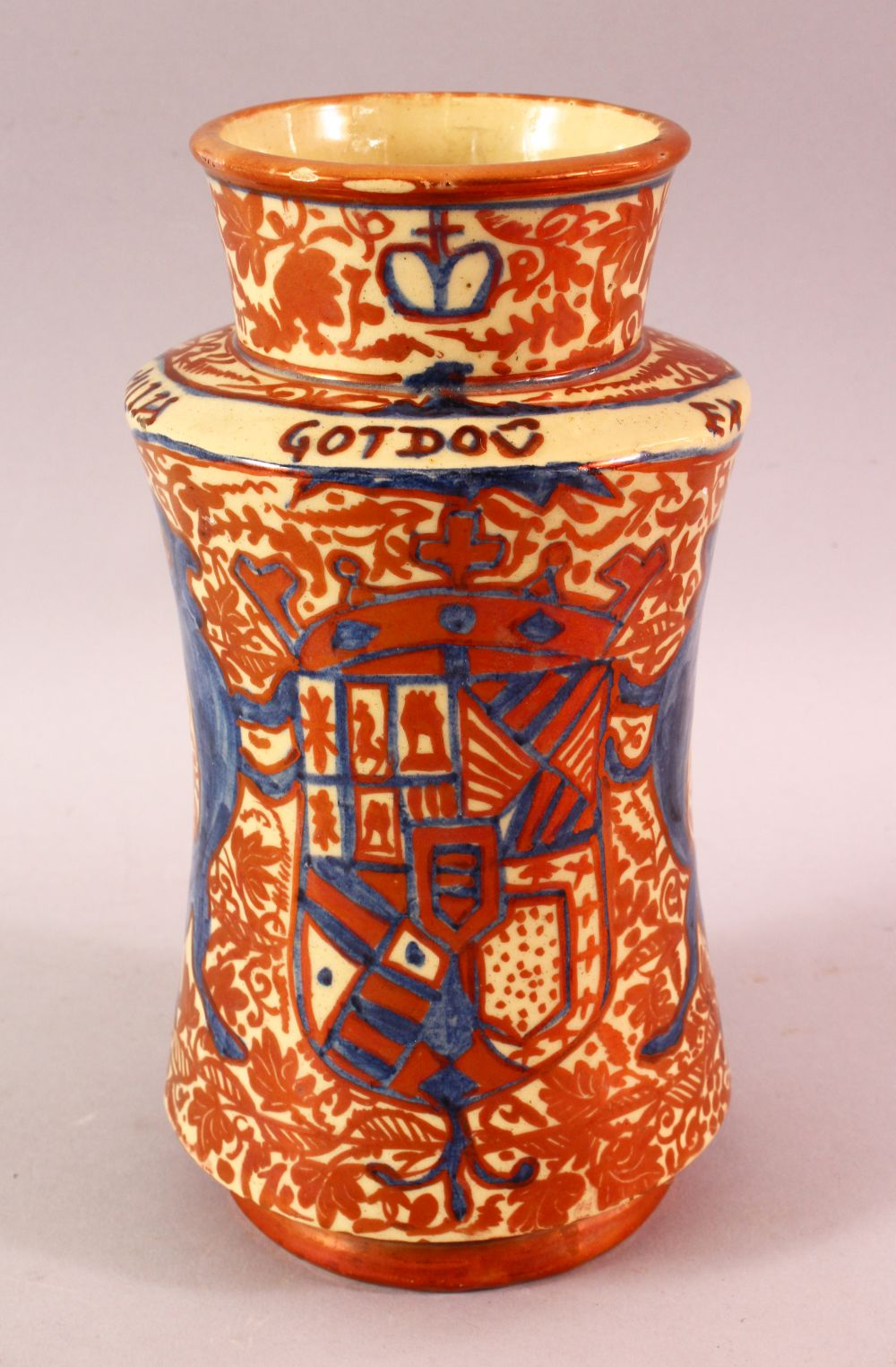 A SPANISH MORESQUE LUSTRE POTTERY MEDICINE JAR, decorated with a copper lustre and lion