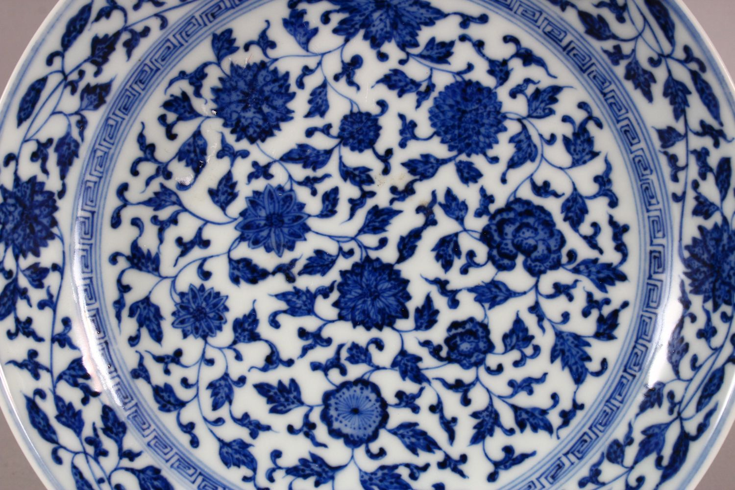 A CHINESE BLUE & WHITE PORCELAIN LOTUS DISH, decorated with sprays of lotus, the underside with a - Image 2 of 5