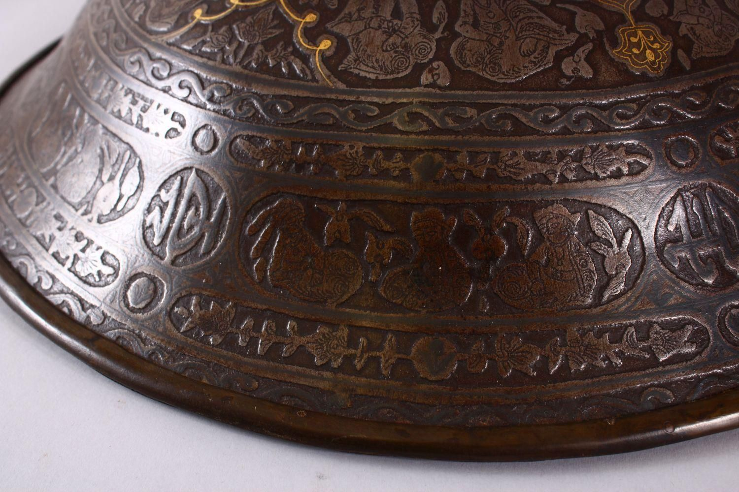 A LARGE 19TH CENTURY PERSIAN GILT DECORATED STEEL SHIELD, with carved decoration of figures, bands - Image 11 of 12