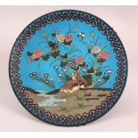 A JAPANESE CLOISONNE CIRCULAR DISH, decorated with quails by a stream, 30cm diameter.