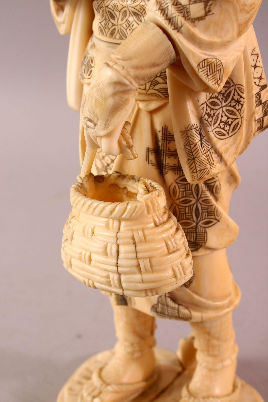 A LARGE JAPANESE MEIJI PERIOD CARVED IVORY OKIMONO - FARMER - the large okimono depicting a female - Image 8 of 11