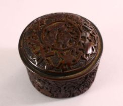 A CHINESE SMALL CIRCULAR CINNABAR LACQUER STYLE BOX AND COVER, decorated with figures in a