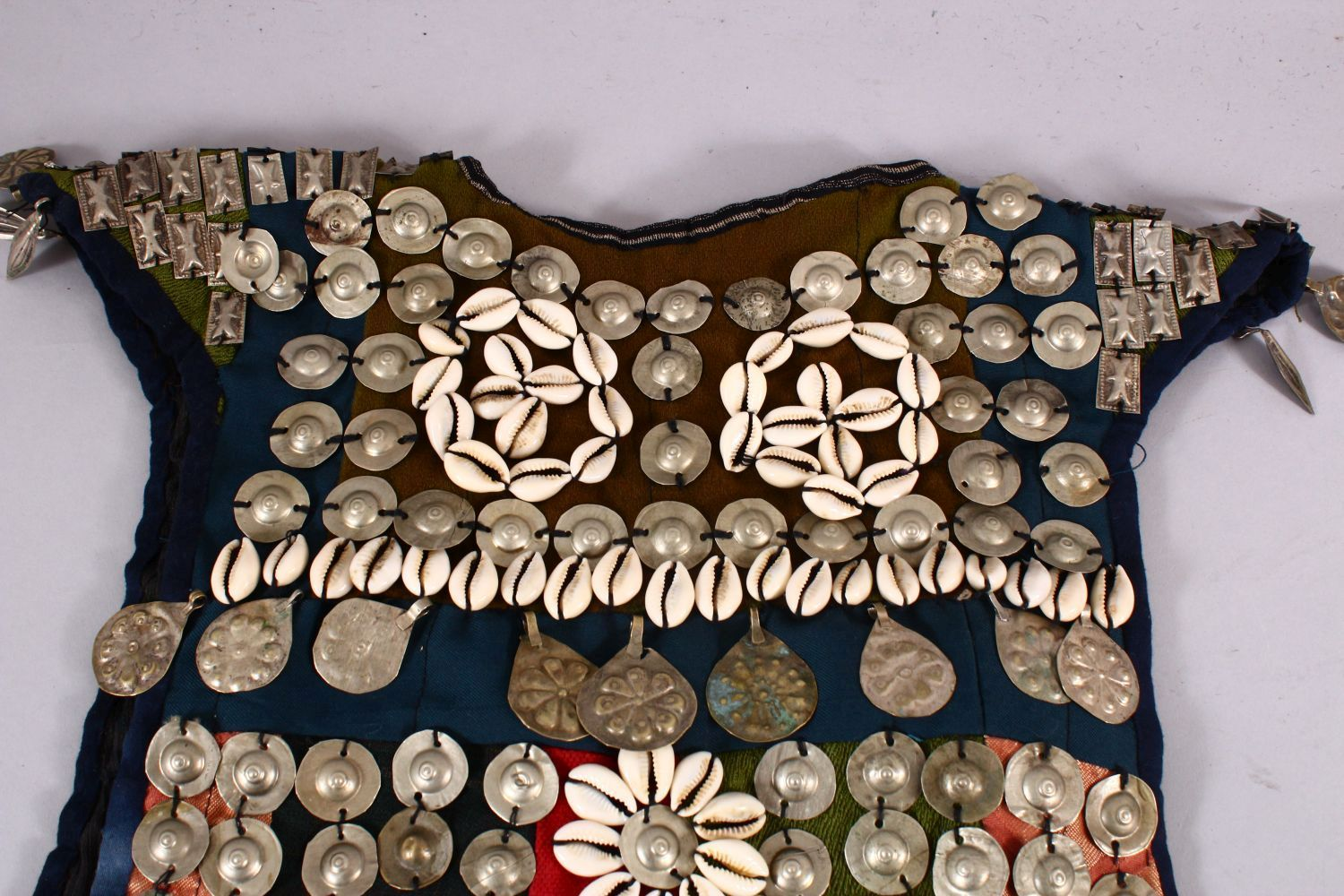 A 19TH CENTURY TURKISH SILVER ONLAID CHILDS DRESS, with silver roundel and shell applications. - Image 3 of 7