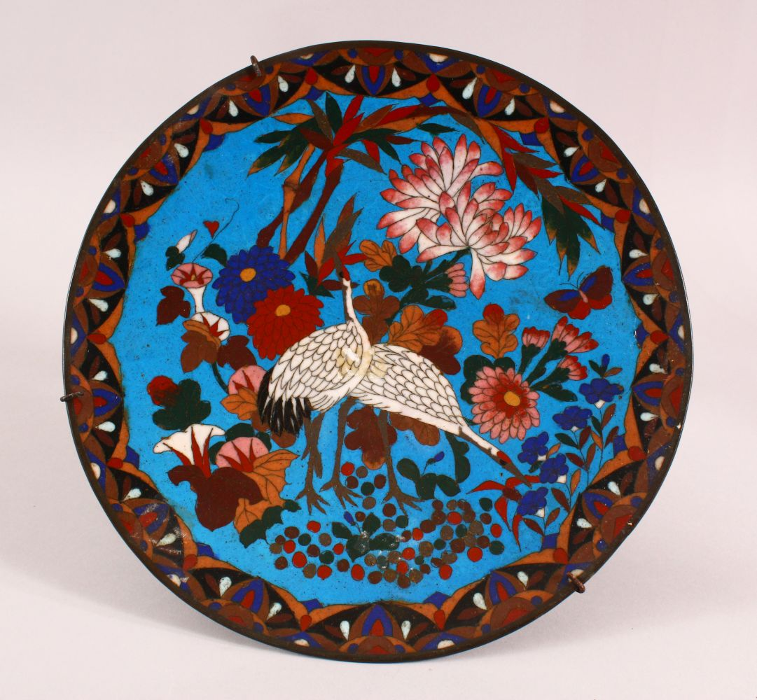 A JAPANESE CLOISONNE DISH, decorated with cranes and flowers, 30cm diameter.
