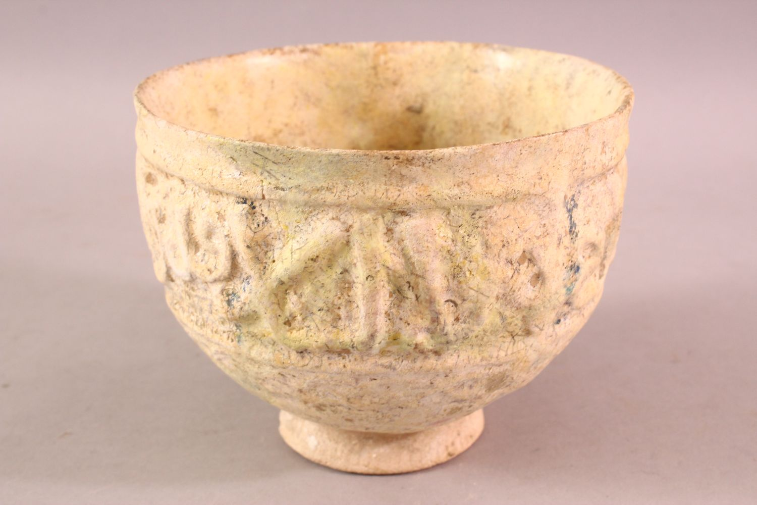 A 12TH CENTURY KUFIC SCRIPT GLAZED POTTERY BOWL, the exterior with moulded script, 15cm diameter, - Image 2 of 6