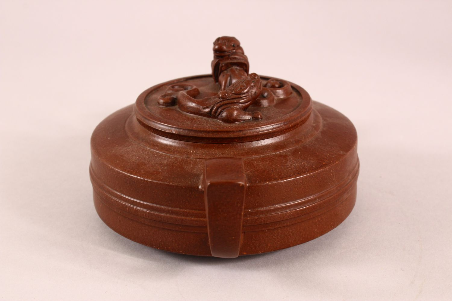 A CHINESE YIXING CLAY TEAPOT, with moulded beast like figures, the underside of the pot and lid with - Image 4 of 8