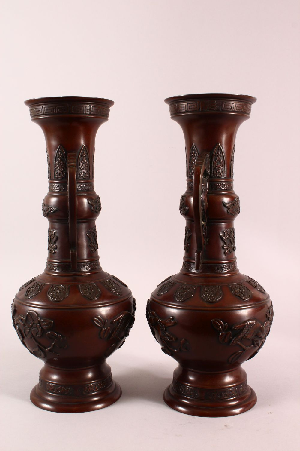 A PAIR OF JAPANESE RELIEF BRONZE VASES, with twin handles, relief birds and flora decoration, 40cm - Image 4 of 7