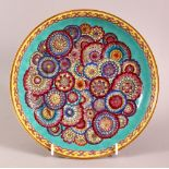 A CHINESE TURQUOISE GLAZED FAMILLE ROSE MILLEFLUER STYLE DISH, decorated with central flora upon