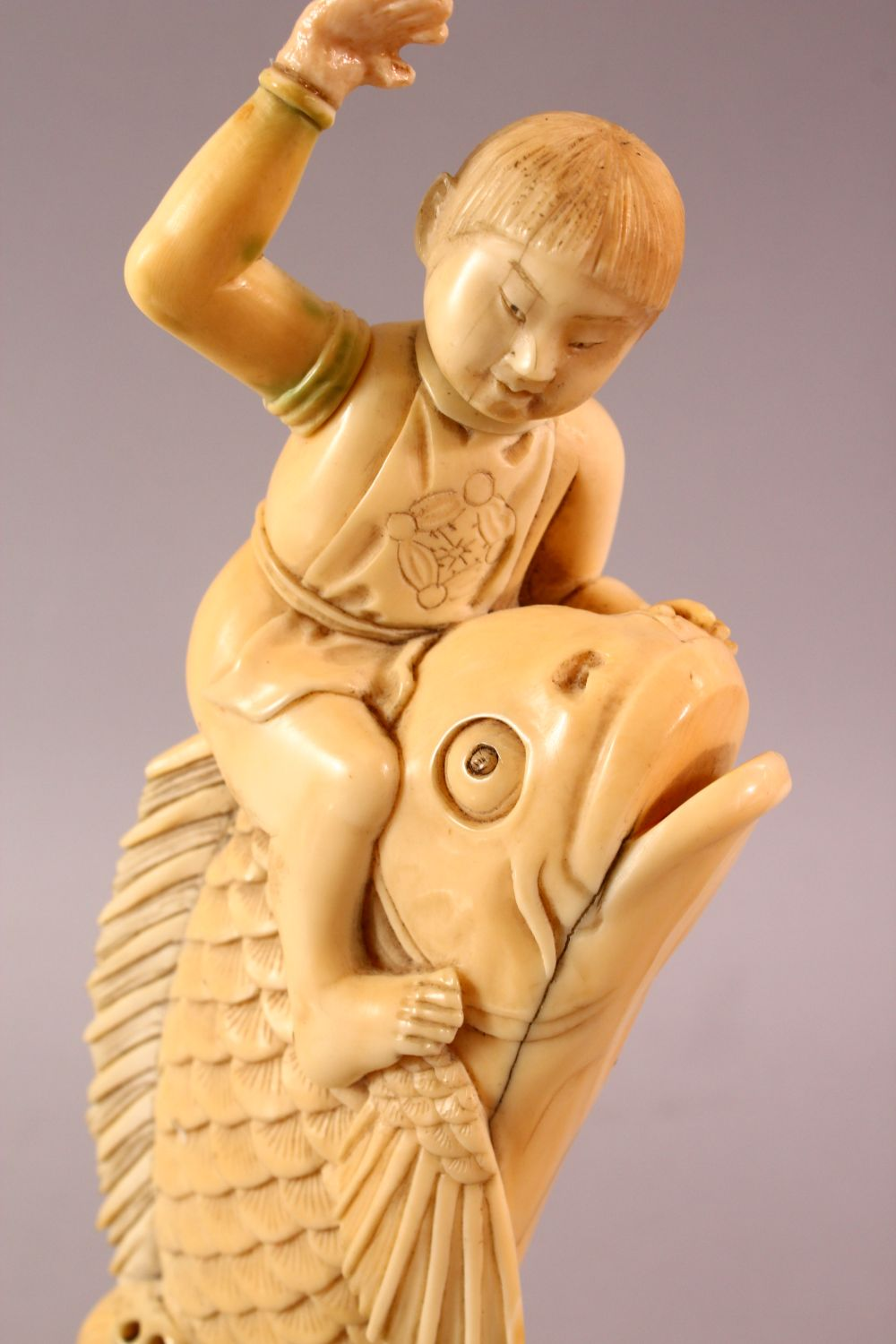 A JAPANESE MEIJI PERIOD CARVED IVORY FISH OKIMONO, the fish emerging from the water with a boy on - Image 6 of 9