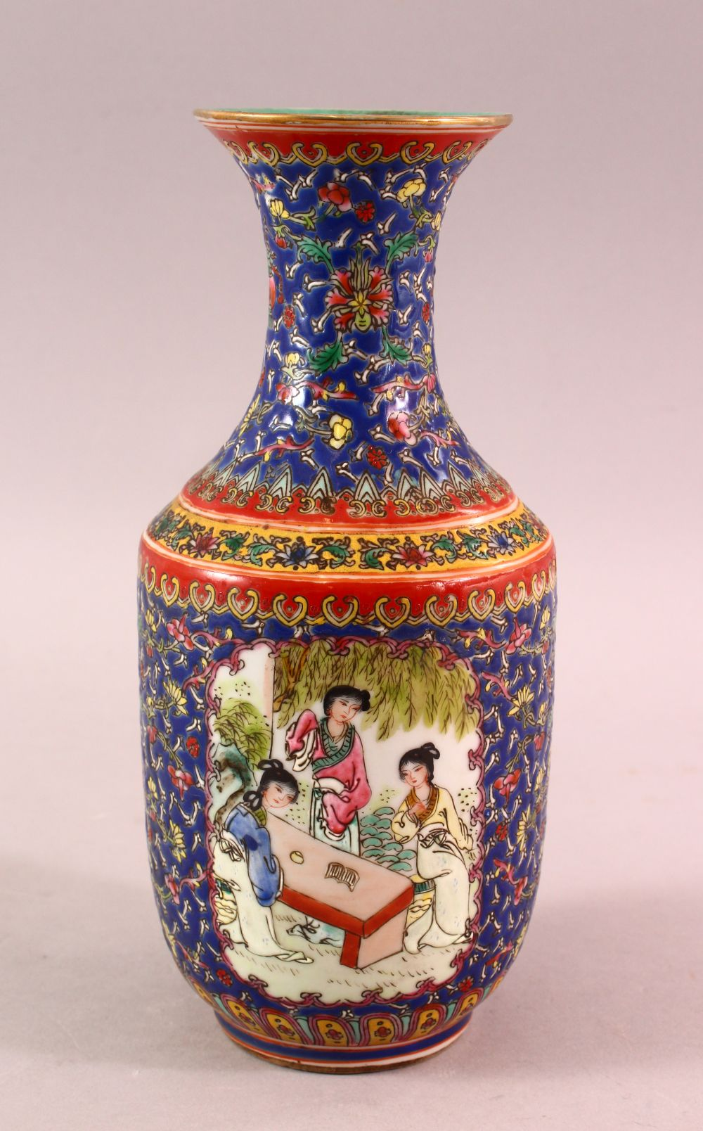 A CHINESE FAMILLE ROSE PORCELAIN VASE, with panels of figures and floral decoration, the base with a