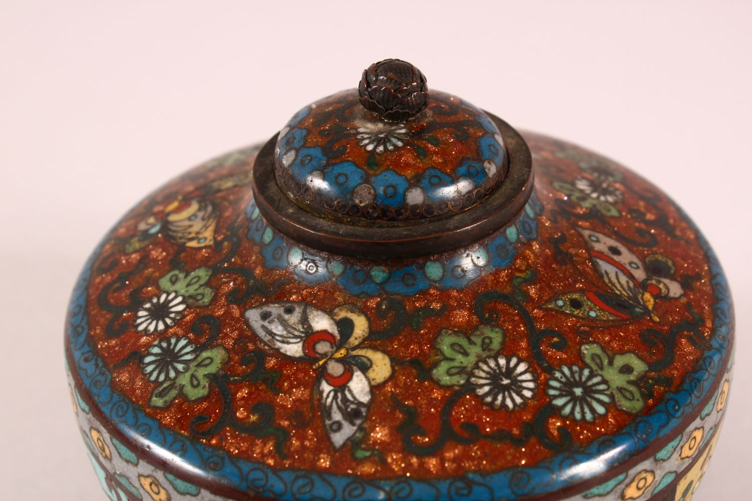 A CLOISONNE KORO AND COVER, decorated with butterflies, flowers and buddhistic emblems, on three - Image 5 of 7