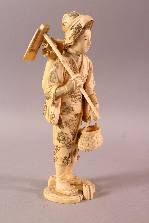 A LARGE JAPANESE MEIJI PERIOD CARVED IVORY OKIMONO - FARMER - the large okimono depicting a female - Image 3 of 11