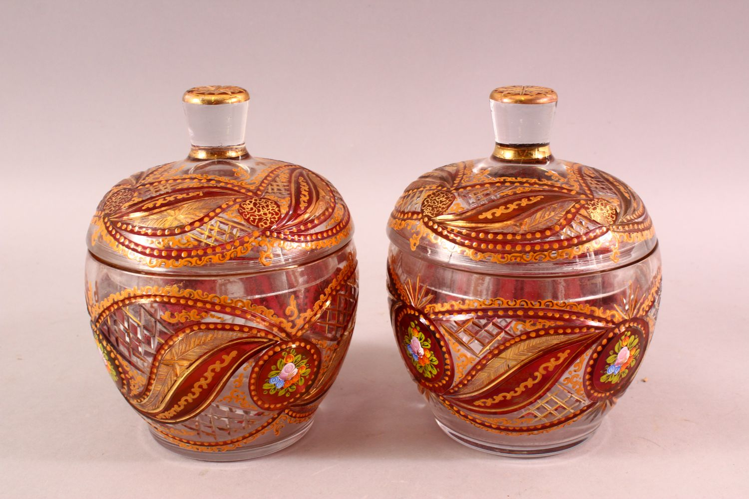 A PAIR OF BOHEMIAN RED ENAMELLED GLASS JARS, each with enamel and gilt work, 20cm each - Image 2 of 4