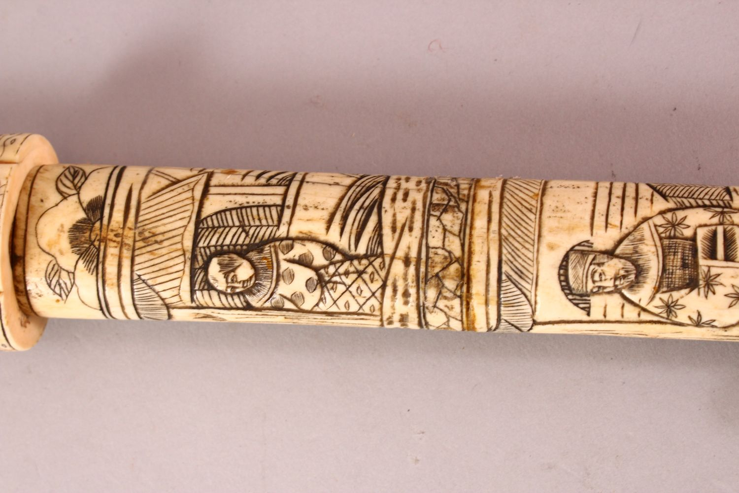 A JAPANESE MEIJI PERIOD SECTIONAL CARVED IVORY SWORD, carved with scenes of figures (AF) 85cm - Image 5 of 7