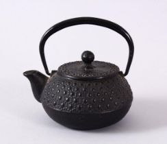 A JAPANESE IRON / METAL MOULDED TEAPOT & COVER, the body with moulded stud decoration, possibly iron