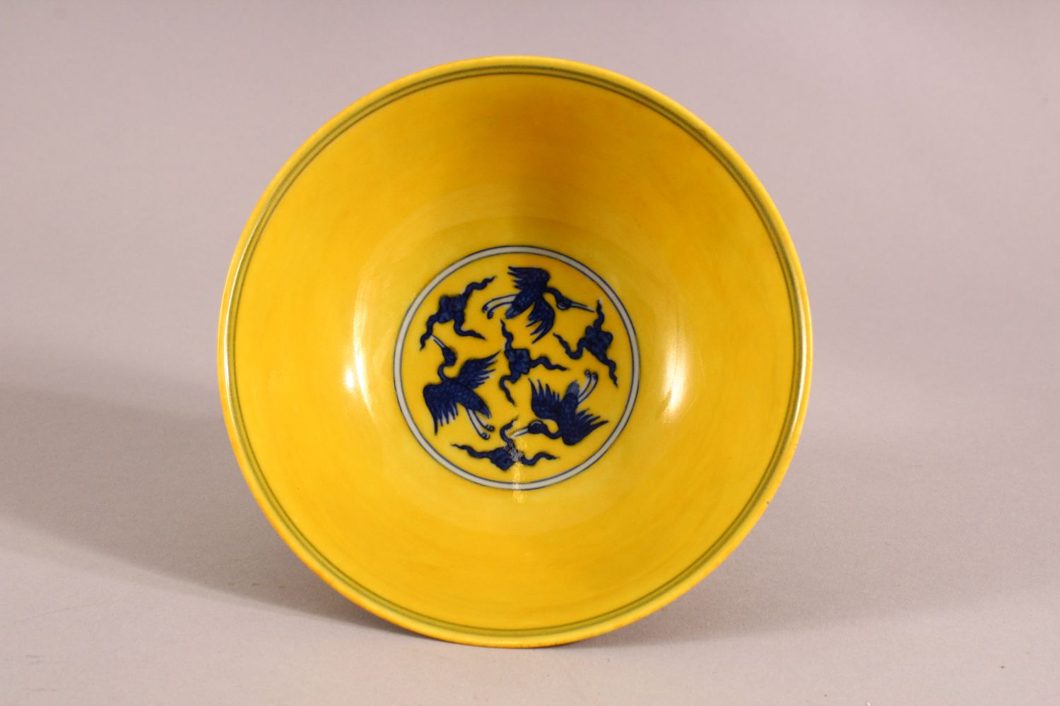 A CHINESE YELLOW GROUND PORCELAIN STEM CUP, decorated with cranes in flight, the interior of the - Image 4 of 6