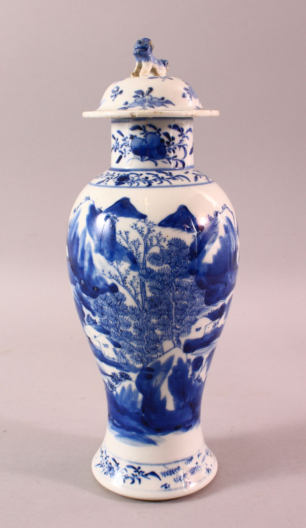 A CHINESE BLUE & WHITE PORCELAIN LANDSCAPE VASE, with decoration of landscapes, with a lion dog