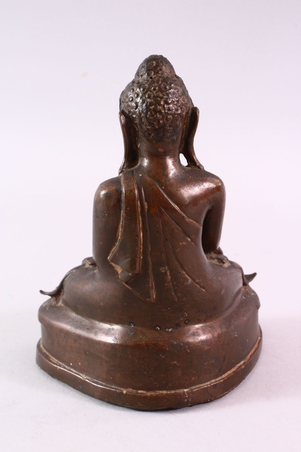 A BRONZE BUDDHA with glass inset eyes, 16cm high. - Image 4 of 6